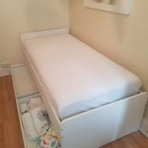 For sale: Ikea single bed included roll out bed and two drawers.
